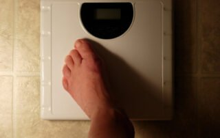 image of Foot on scale for weightloss